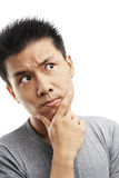 Thoughful Asian young man Stock Images