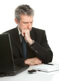 Thoughful business man working on laptop Royalty Free Stock Photo