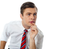 Thoughful business person. Looking up at something interesting Royalty Free Stock Image