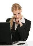 Thoughful business woman working on laptop Royalty Free Stock Image