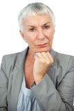 Thoughful woman looking at camera. On white background royalty free stock photos