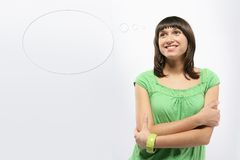 Thought balloon. Young girl having a thought balloon Royalty Free Stock Images