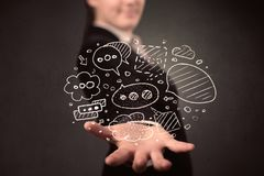 Woman holding speech bubbles. Thought bubbles in the hands of a young casual businesswoman Stock Photography