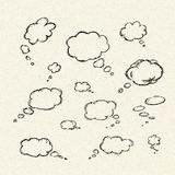 Thought bubbles on of a sheet of lined paper Royalty Free Stock Images