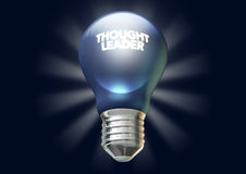 Thought leader light bulb. A regular blue light bulb with the phrase thought leadership illuminated on it on an isolated dark blue background with stylized Royalty Free Stock Photos
