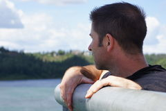 Thought. Man looking over bridge in contemplation Royalty Free Stock Image
