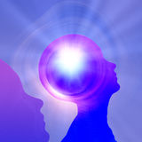 Thought Power. 2 figures 1 emanates light Stock Image