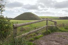 Silbury Hill Wiltshire. Thought to have been completed in 2400 BC the Neolithic Silbury Hill in Wiltshire England is the largest man made mound in Europe. It is royalty free stock photography