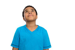 Thoughtful African American Boy Looking Up High. Half Body Shot of a Thoughtful African American Boy Looking Up High Against White Background Royalty Free Stock Photos