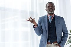 thoughtful african american businessman in blue jacket gesturing royalty free stock images