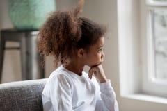 Thoughtful African American Preschooler Girl Looking In Window Royalty Free Stock Images