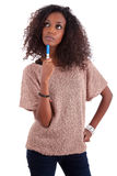 Thoughtful African American woman looking up stock photography