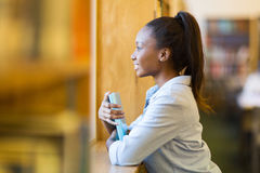 Thoughtful african college girl Stock Photos