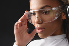 Thoughtful african woman working with headset Stock Photo