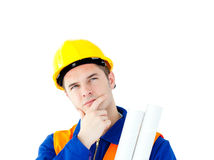 Thoughtful architect holding blueprints Stock Photography