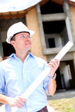 Thoughtful architect holding blueprints Royalty Free Stock Photos