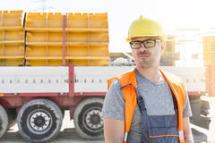 Thoughtful architect standing against truck at construction site stock photo