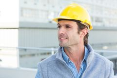 Thoughtful architect wearing yellow hard hat Royalty Free Stock Image