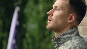 Thoughtful army veteran taking military cap, memorial day, post-traumatic stress. Stock footage stock video