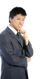 Thoughtful Asian businessman Royalty Free Stock Photos