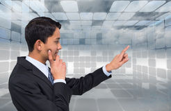 Thoughtful asian businessman pointing Stock Photography