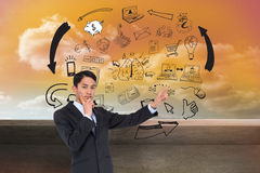 Thoughtful asian businessman pointing Royalty Free Stock Photos