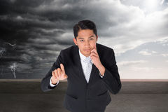 Thoughtful asian businessman pointing Stock Photos