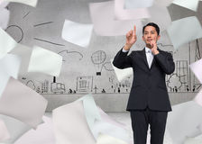 Thoughtful asian businessman pointing Stock Image