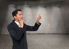 Thoughtful asian businessman pointing Stock Images