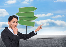 Thoughtful asian businessman pointing Royalty Free Stock Images