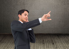 Thoughtful asian businessman pointing Royalty Free Stock Photo