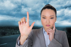 Thoughtful asian businesswoman pointing Royalty Free Stock Photos