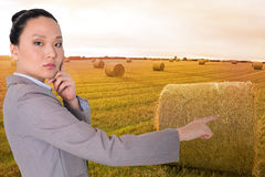 Thoughtful asian businesswoman pointing Stock Image