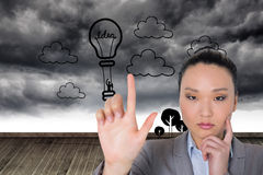 Thoughtful asian businesswoman pointing Royalty Free Stock Photo
