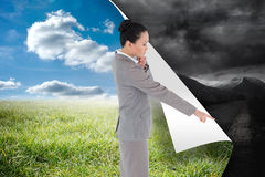 Thoughtful asian businesswoman pointing Stock Photo