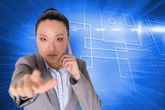 Thoughtful asian businesswoman pointing Royalty Free Stock Image