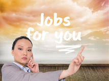 Thoughtful asian businesswoman pointing Stock Photos