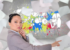 Thoughtful asian businesswoman pointing Stock Images