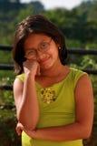 Thoughtful Asian girl Stock Image