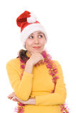 Thoughtful asian girl in santa's hat Royalty Free Stock Photography