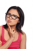Thoughtful Asian woman in glasses Royalty Free Stock Photos
