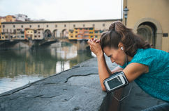 Thoughtful athletic female staying next to Ponte Vecchio bridge Royalty Free Stock Photography