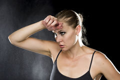 Thoughtful Athletic Woman with Hand on Forehead Royalty Free Stock Photography