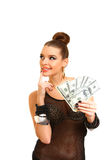 Thoughtful attractive brunette holding dollars  Stock Image