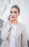 Thoughtful attractive businesswoman on the phone Royalty Free Stock Images