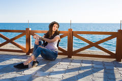 Thoughtful attractive woman dressed in stylish clothes enjoying good sunny weather during promenade Stock Photography