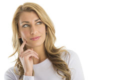 Thoughtful Attractive Woman Looking Sideways. Thoughtful young attractive woman looking sideways against white background Stock Image