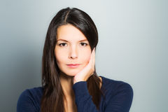 Thoughtful attractive woman with a serene face Royalty Free Stock Photography