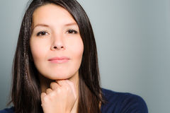 Thoughtful attractive woman with a serene face Royalty Free Stock Image