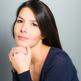 Thoughtful attractive woman with a serene face Stock Image